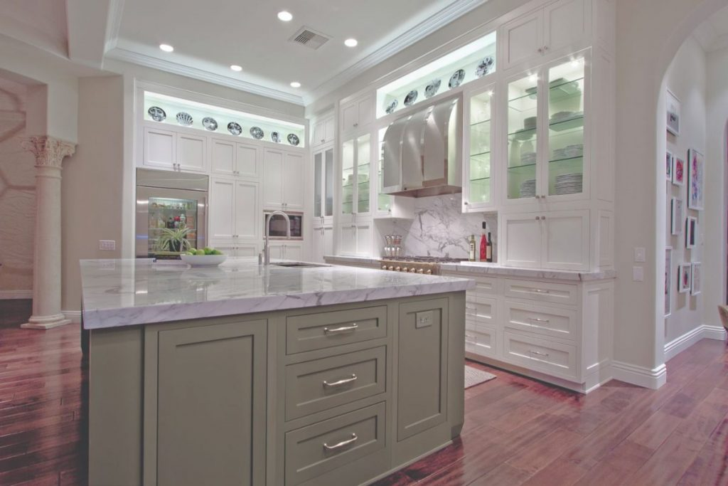 Builders Preferred finished kitchen project with a painted green island and perimeter painted white cabinets.